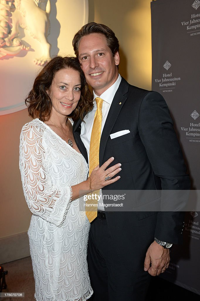 Fitna and Axel Ludwig attend the Sommerfest Eclat Dore at Hotel Vier Jahreszeiten on July 30, 2013 in Munich, Germany.