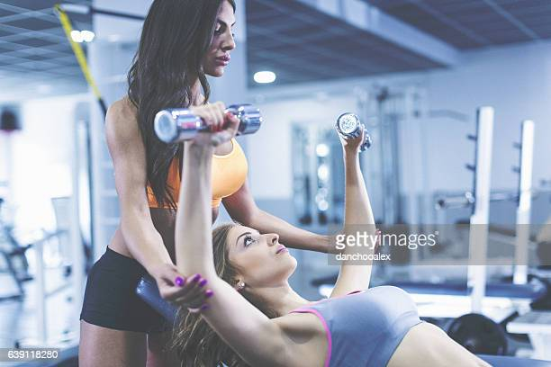 Fitnes instructor helping