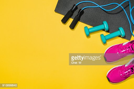 Fitness accessories on yellow background mock up, top view : Stock Photo