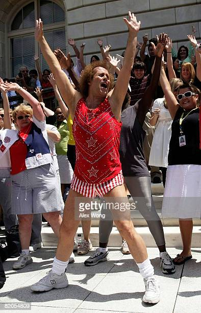 Fitness advocate Richard Simmons dances with fans during a rally on Capitol Hill July 24 2008 in Washington DC Simmons was on the Hill for a hearing...