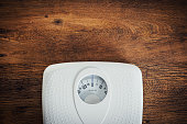 White scale on a wooden table top view, fitness and weight loss concept