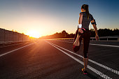 stretching run runner road jogging clothes flare sunset street fitness cross sunbeam success running sportswear - stock image