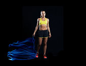 fitness athlete with skipping rope and light trail