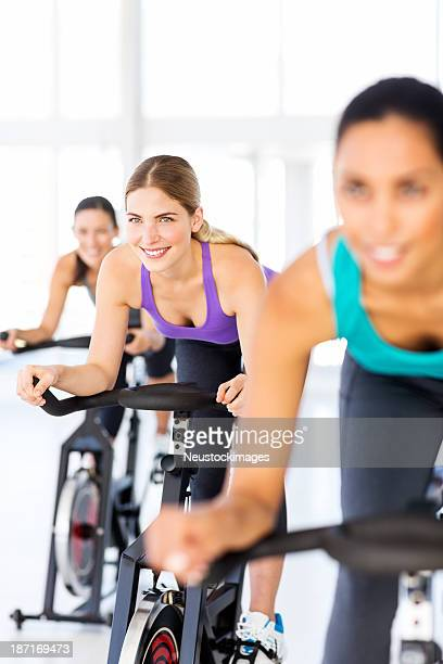 Fitness Class Spinning In Health Club