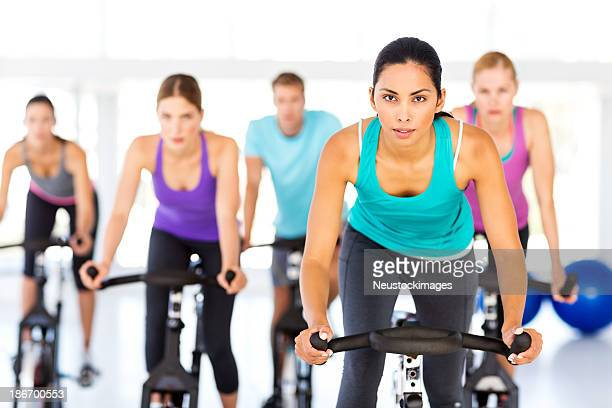 Fitness Class On Bikes In Gym