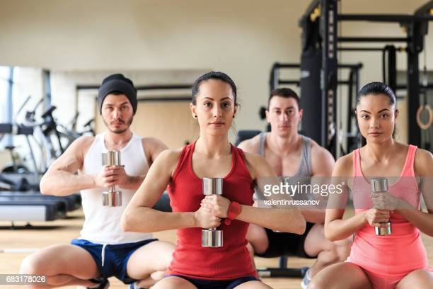 Fitness class workout with dumbbells in gym