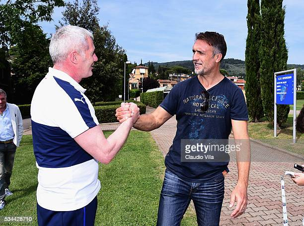 Fitness Coach Italy Paolo Bertelli and Gabriel Omar Batistuta attend the Italy training session at the club's training ground at Coverciano on May 26...