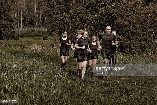 fitness coach jogging with a group of female friends