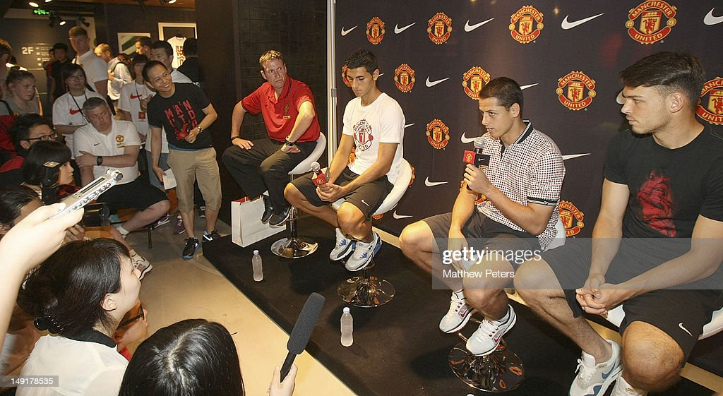 Fitness Coach Tony Strudwick, Davide Petrucci, Javier 'Chicharito' Hernandez and Frederic Veseli of Manchester United attend the launch of a new Manchester United Fitness app in association with Nike on July 24, 2012 in Shanghai, China.