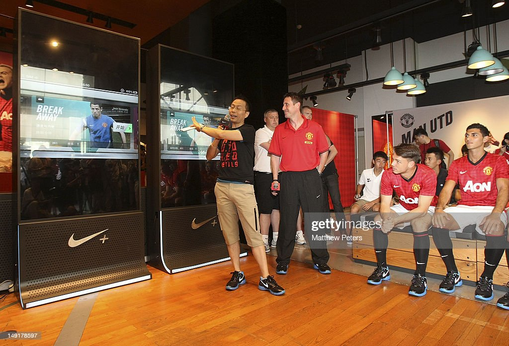 Fitness Coach Tony Strudwick, Frederic Veseli and Davide Petrucci of Manchester United attend the launch of a new Manchester United Fitness app in association with Nike on July 24, 2012 in Shanghai, China.