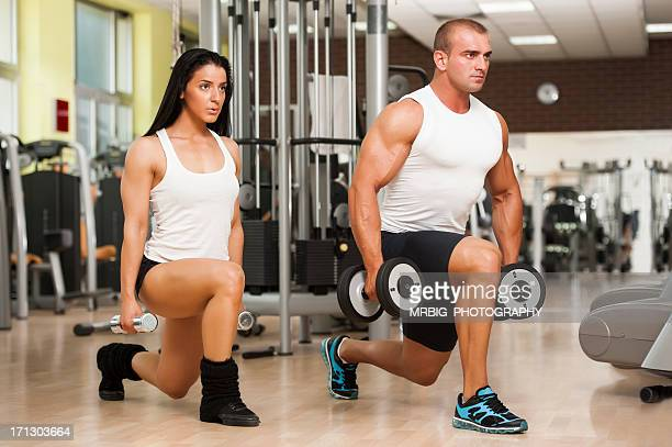 Fitness Couple Doing Lunges With Hand Weights