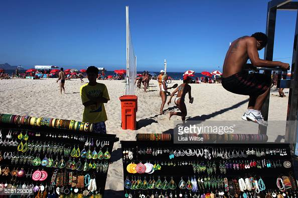 Fitness enthusiast works out at the many fitness workstations along the beaches of Rio de Janeiro Brazil Copacabana Beach July 05 2010 Photo by Lisa...