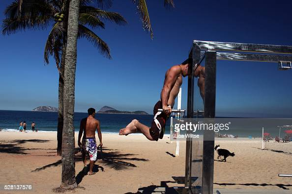 Fitness enthusiasts work out at the many fitness workstations along the beaches of Rio de Janeiro Brazil Copacobana Beach July 05 2010 Photo by Lisa...