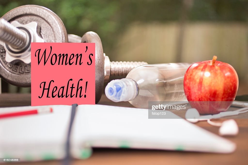 Fitness, exercise themed scene with Women's Health note. : Stock Photo