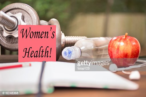 Fitness, exercise themed scene with Women's Health note. : Foto de stock