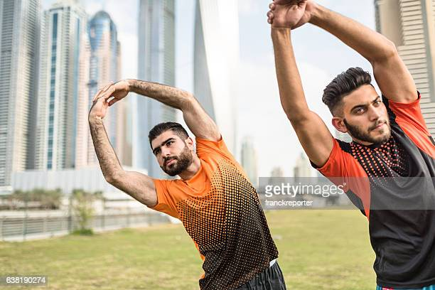 fitness friends doing stretching in dubai marina