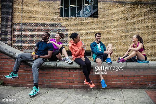 Fitness friends having a break in London Tower Bridge