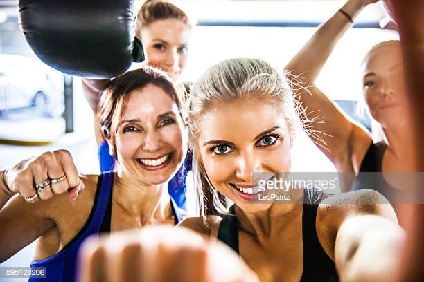 Fitness friends having a break with selfie post workout