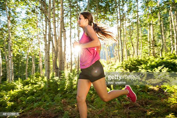 Fitness Girl Running in Aspen Grove at Sunset