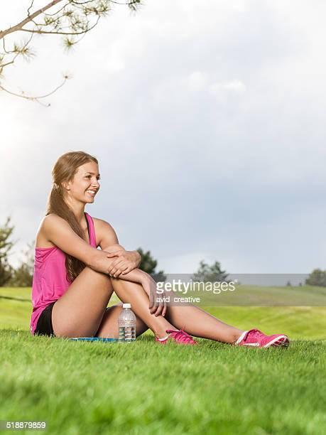 Fitness Girl Sitting in Park