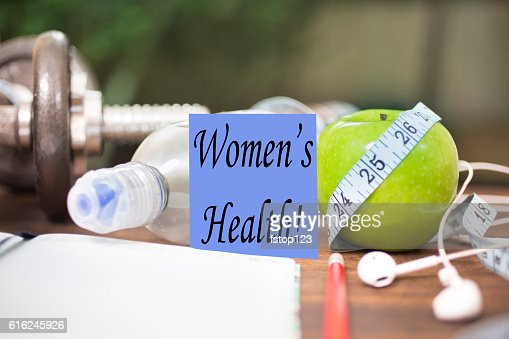 Fitness, health themed scene with Women's Health note. : Stock Photo