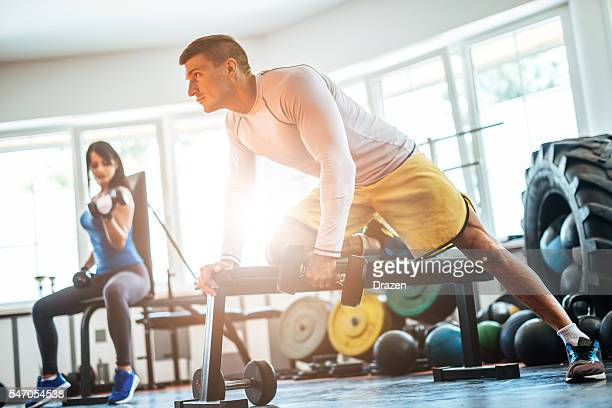 Fitness instructor and young woman exercising cross training