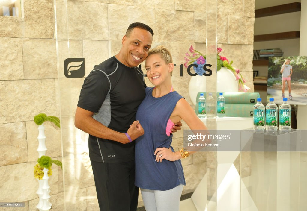Fitness instructor Dion Jackson (L) and actress Kate Hudson celebrate the Fabletics Spring Collection on May 1, 2014 in Los Angeles, California.