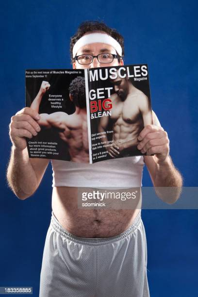 Fitness Man Reading Muscle Magazine