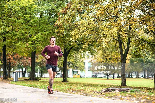 Fitness man running in Berlin under the rain in autumn
