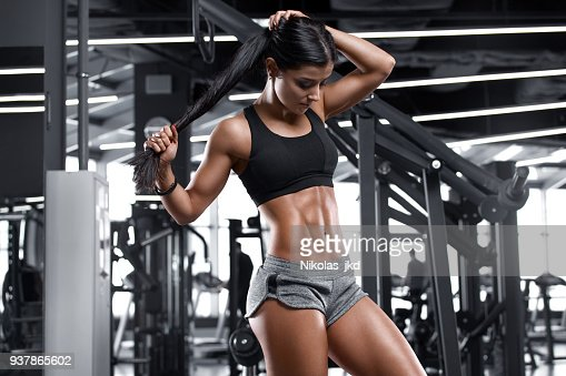 Fitness sexy woman showing abs and flat belly. Beautiful muscular girl, shaped abdominal : Stock Photo