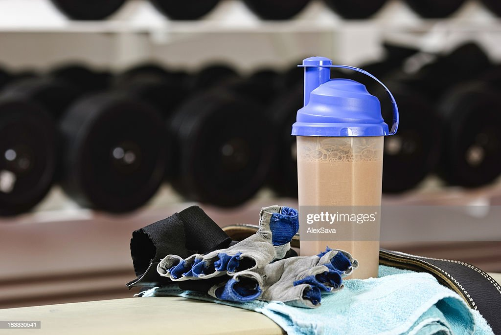 Fitness shake and gear in gym : Stock Photo
