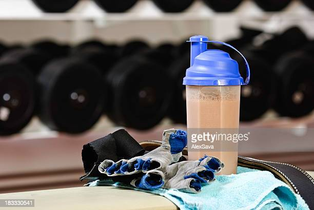 Fitness shake and gear in gym