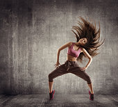 Fitness Sport Dance, Woman Dancer Flying Hair Dancing over Concrete background