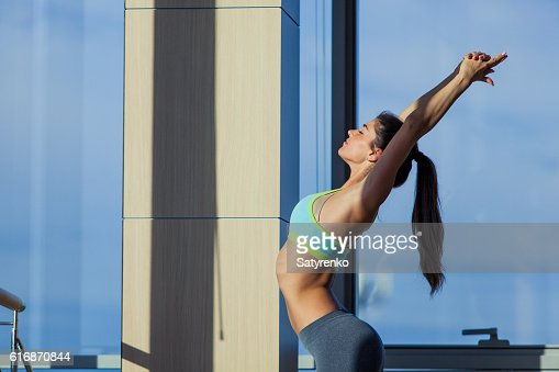 fitness, sport, training and lifestyle concept - smiling woman stretching : Stock Photo