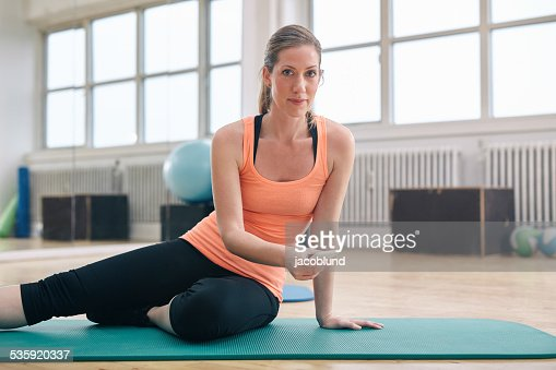 Fitness woman at gym with a smartphone : Stock Photo