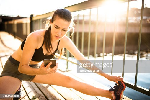 fitness woman checking the phone : Foto de stock