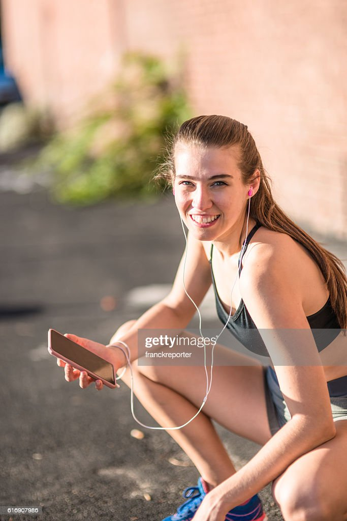 fitness woman checking the phone : Stock Photo