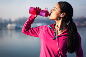 Fitness woman drinking waterFitness woman drinking water after jogging