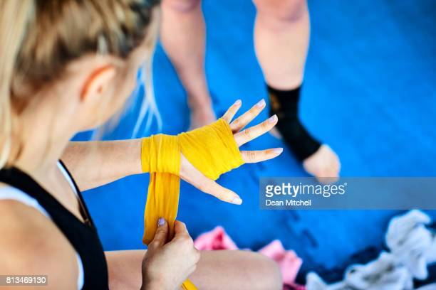 Fitness woman getting ready for kickboxing workout in gym