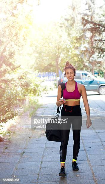 Fitness woman go to gym for training.