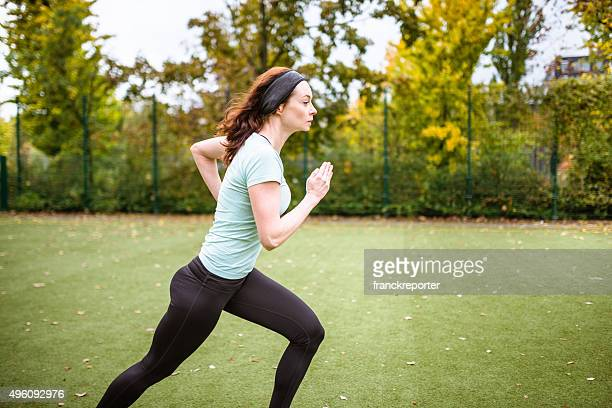 Fitness woman running on the park
