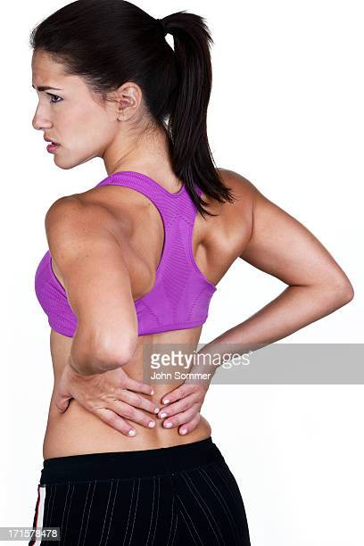 Fitness woman with back pain