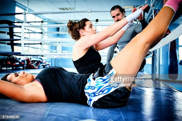 Fitness women exercising with personal trainer
