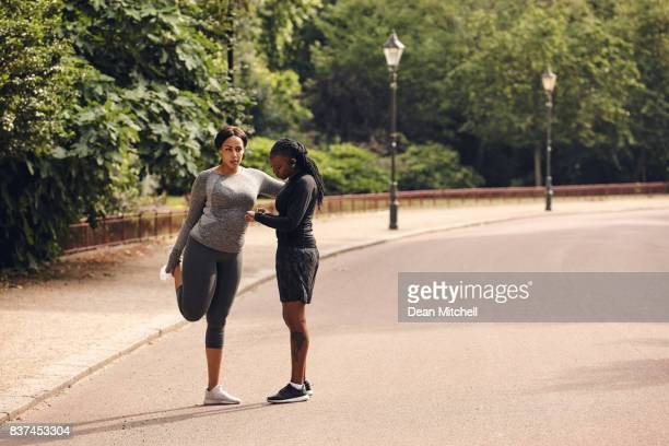 Fitness women stretching on street after morning run