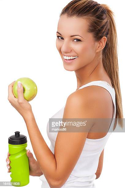 Fitness women with bottle and apple