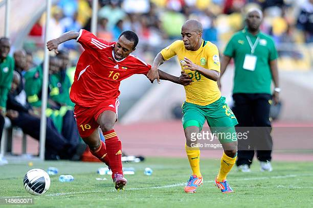 Fitsum Teklehaimanot of Ethiopia and Oupa Manyisa of South Africa compete during the 2014 FIFA World Cup Qualifier match between South Africa and...