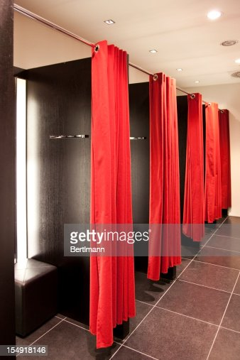 Fitting rooms with red curtains