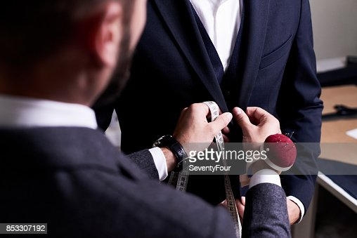 Fitting Suit to Model : Stock Photo
