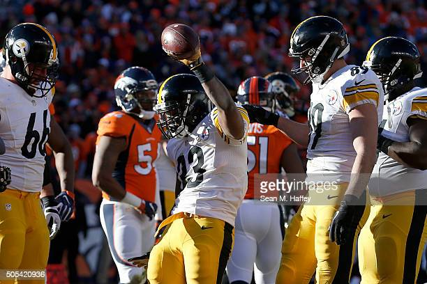 Fitzgerald Toussaint of the Pittsburgh Steelers celebrates after scoring a one yard touchdown in the first quarter against the Denver Broncos during...