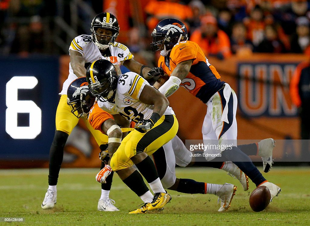 Fitzgerald Toussaint #33 of the Pittsburgh Steelers fumbles the ball against the Denver Broncos during the AFC Divisional Playoff Game at Sports Authority Field at Mile High on January 17, 2016 in Denver, Colorado.